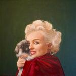 Marilyn Monroe with a Pekingese Dog